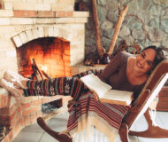 Woman,Reading,Book,And,Relaxing,By,The,Fire,Place,Some